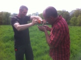 """Eric and Abe use the """"Vermont garlic press"""" to squeeze some liquid from a grass sample onto the refractometer."""